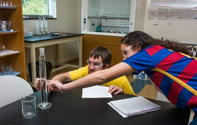 Students measure liquids in science class