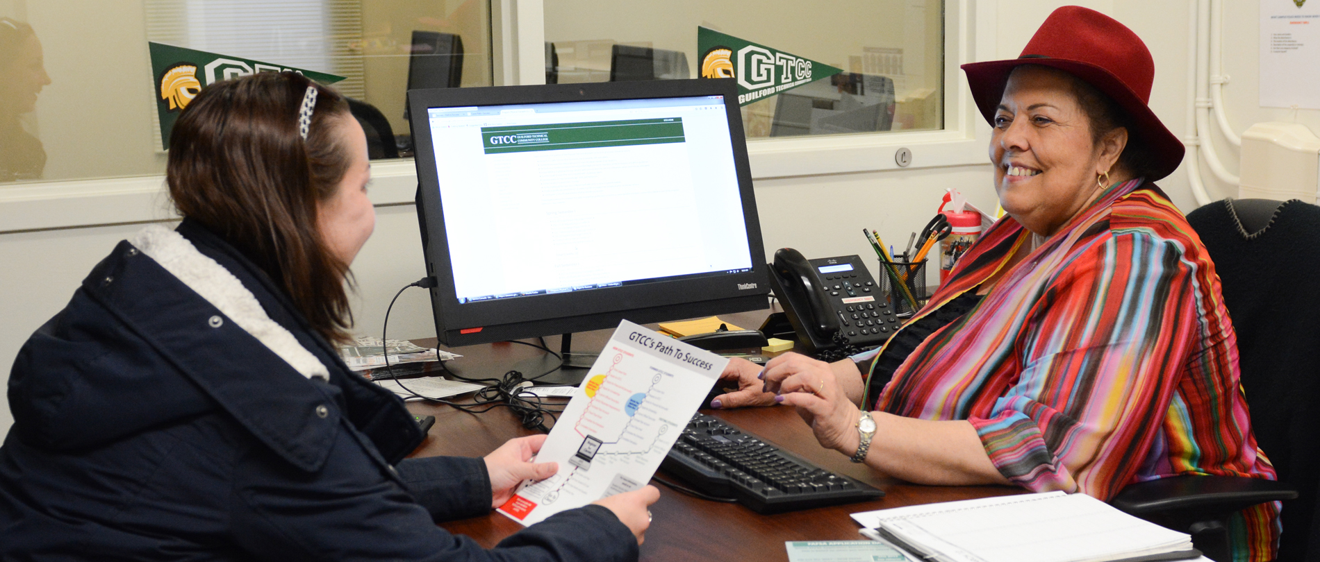 Student works with financial aid adviser